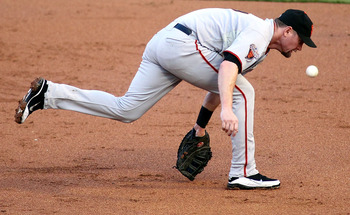 MIAMI GARDENS, FL - AUGUST 12:  First baseman Aubrey Huff #17 of the San Francisco Giants cannot make the play against the Florida Marlins at Sun Life Stadium on August 12, 2011 in Miami Gardens, Florida.  (Photo by Marc Serota/Getty Images)