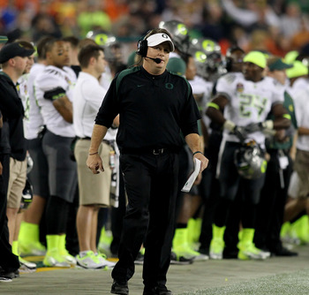 GLENDALE, AZ - JANUARY 10:  Head coach Chip Kelly of the Oregon Ducks looks on from the bench against the Auburn Tigers in the Tostitos BCS National Championship Game at University of Phoenix Stadium on January 10, 2011 in Glendale, Arizona.  (Photo by Jo