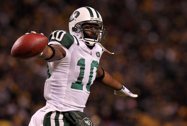 PITTSBURGH, PA - JANUARY 23: Santonio Holmes #10 of the New York Jets celebrates after he scored a third quarter touchdown against the Pittsburgh Steelers during the 2011 AFC Championship game at Heinz Field on January 23, 2011 in Pittsburgh, Pennsylvania