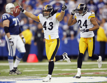 INDIANAPOLIS - JANUARY 15:  Troy Polamalu #43 of the Pittsburgh Steelers runs ahead of teammate Ike Taylor #24 as he celebrates an interception, the interception was overturned when the ball was ruled incomplete after a replay challenge against the Indian