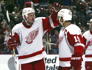 DETROIT - APRIL 7:  Jason Williams #29 of the Detroit Red Wings celebrates his goal against the Columbus Blue Jackets with teammate Steve Yzerman #19 during the second period of their NHL game at Joe Louis Arena April 7, 2006 in Detroit, Michigan.  (Photo