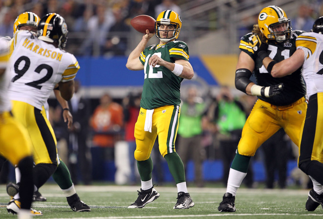 ARLINGTON, TX - FEBRUARY 06: Aaron Rodgers #12 of the Green Bay Packers looks to pass against the Pittsburgh Steelers during Super Bowl XLV at Cowboys Stadium on February 6, 2011 in Arlington, Texas.  (Photo by Jamie Squire/Getty Images)