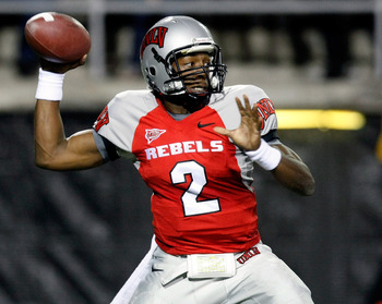 LAS VEGAS - NOVEMBER 13:  Quarterback Omar Clayton #2 of the UNLV Rebels throws against the Wyoming Cowboys during their game at Sam Boyd Stadium November 13, 2010 in Las Vegas, Nevada.  (Photo by Ethan Miller/Getty Images)