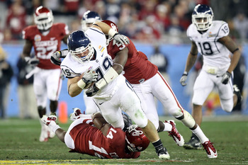 GLENDALE, AZ - JANUARY 01:  Anthony Sherman #49 of the Connecticut Huskies runs the ball in the fourth quarter against the Oklahoma Sooners during the Tostitos Fiesta Bowl at the Universtity of Phoenix Stadium on January 1, 2011 in Glendale, Arizona.  (Ph