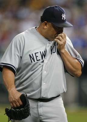 KANSAS CITY, MO - AUGUST 17:  Starting pitcher Bartolo Colon #40 of the New York Yankees wipes his face while walking to the dugout in the fifth inning during a game against the Kansas City Royals at Kauffman Stadium on August 17, 2011 in Kansas City, Mis