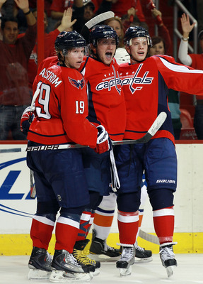WASHINGTON - OCTOBER 13:  Alex Ovechkin #8 of the Washington Capitals (C) celebrates with Nicklas Backstrom #19 and another teammate against the New York Islanders at the Verizon Center on October 13, 2010 in Washington, DC.  (Photo by Bruce Bennett/Getty