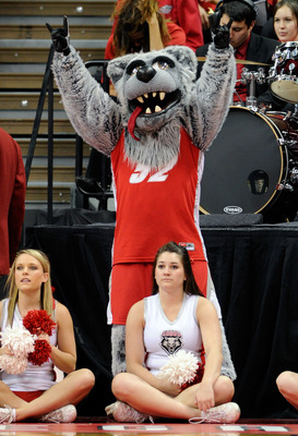 LAS VEGAS, NV - MARCH 10:  New Mexico Lobos mascot Lobo Louie appears behind Lobos cheerleaders during a quarterfinal game of the Conoco Mountain West Conference Basketball tournament against the Colorado State Rams at the Thomas & Mack Center March 10, 2