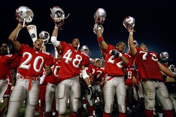 5 Sep 1998:  Members of the University of New Mexico Lobos celebrate during a game against the Idaho State Bengals at the University Stadium in Albuquerque, New Mexico. The Lobos defeated the Bengals 38-9.