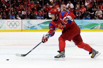 VANCOUVER, BC - FEBRUARY 24:  Alexander Ovechkin #8 of Russia controls the puck during the ice hockey men's quarter final game between Russia and Canada on day 13 of the Vancouver 2010 Winter Olympics at Canada Hockey Place on February 24, 2010 in Vancouv