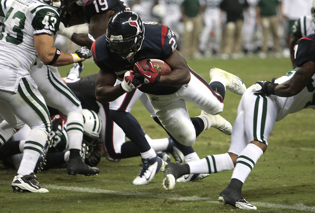 HOUSTON - AUGUST 15:  Running back Chris Ogbonnaya #27 of the Houston Texans dives for a one yard touchdown in the fourth quarter against the New York Jets at Reliant Stadium on August 15, 2011 in Houston, Texas. Houston won 20-16. (Photo by Bob Levey/Get