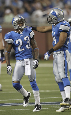 DETROIT - AUGUST 12:  Chris Houston #23 of the Detroit Lions celebrates with teammate DeAndre Levy #54 after intercepting a pass from Andy Dalton #14 of the Cincinnati Bengals in the first quarter of the game at Ford Field on August 12, 2011 in Detroit, M