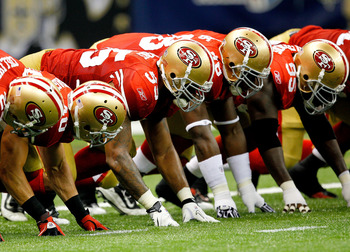NEW ORLEANS, LA - AUGUST 12:  San Francisco 49ers players crowd the line as their team plays the New Orleans Saints during their pre season game at Louisiana Superdome on August 12, 2011 in New Orleans, Louisiana.  (Photo by Sean Gardner/Getty Images)