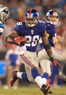 CHARLOTTE, NC - AUGUST 13:  D.J. Ware #28 of the New York Giants against the Carolina Panthers during their preseason game at Bank of America Stadium on August 13, 2011 in Charlotte, North Carolina.  (Photo by Streeter Lecka/Getty Images)