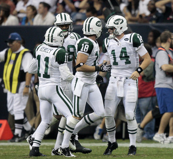 HOUSTON - AUGUST 15:  Quarterback Greg McElroy #14 of the New York Jets celebrates after a two yard score in the third quarter against the Houston Texans at Reliant Stadium on August 15, 2011 in Houston, Texas.  (Photo by Bob Levey/Getty Images)