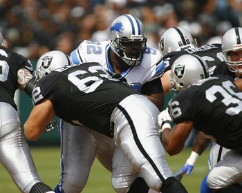 OAKLAND, CA - SEPTEMBER 9:  Defensive tackle Shaun Rogers #92 of the Detroit Lions sheds a block by center Jeremy Newberry #62 of the Oakland Raiders during their game at McAfee Coliseum on September 9, 2007 in Oakland, California.  The Lions defeated the