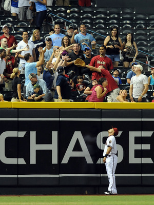 PHOENIX, AZ - JULY 19:  Gerardo Parra #8 of the Arizona Diamondbacks stands at the fence and watches the ball fly into the left field bleachers against the Milwaukee Brewers at Chase Field on July 19, 2011 in Phoenix, Arizona.  (Photo by Norm Hall/Getty I