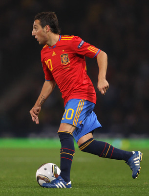 GLASGOW, SCOTLAND - OCTOBER 12:  Santiago Cazorla of Spain runs with the ball during the UEFA EURO 2012 Group I Qualifier match between Scotland and Spain at Hampden Park on October 12, 2010 in Glasgow, Scotland.  (Photo by Alex Livesey/Getty Images)