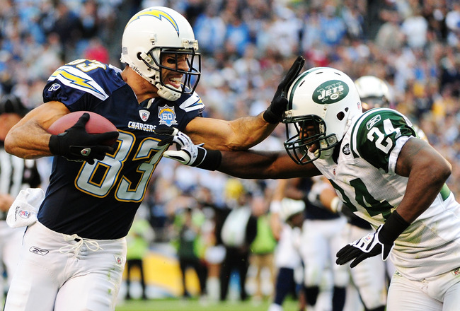 SAN DIEGO - JANUARY 17:  Wide receiver Vincent Jackson #83 of the San Diego Chargers stiff-arms cornerback Darrelle Revis #24 of the New York Jets during  AFC Divisional Playoff Game at Qualcomm Stadium on January 17, 2010 in San Diego, California.  (Phot