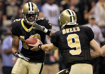 NEW ORLEANS - JANUARY 24:  Quarterback Drew Brees #9 of the New Orleans Saints hands the ball off to Marques Colston #12 against the Minnesota Vikings during the NFC Championship Game at the Louisana Superdome on January 24, 2010 in New Orleans, Louisiana