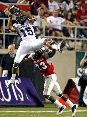 LAS VEGAS - OCTOBER 02:  Rishard Matthews #15 of the Nevada Reno Wolf Pack grabs a reception over Sidney Hodge #23 UNLV Rebels during the third quarter of their game at Sam Boyd Stadium October 2, 2010 in Las Vegas, Nevada. Nevada Reno won 44-26.  (Photo