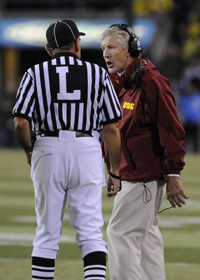 EUGENE, OR - OCTOBER 31: Head coach Pete Carroll of the USC Trojans speaks to an official in the third quarter of the game against the Oregon Ducks at Autzen Stadium on October 31, 2009 in Eugene, Oregon. The Ducks upset the Trojans 47-20. (Photo by Steve