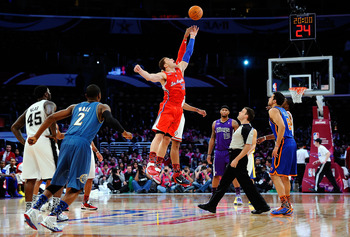 LOS ANGELES, CA - FEBRUARY 18:  Blake Griffin #32 of the Los Angeles Clippers and the Rookie Team and Taj Gibson #22 of the Chicago Bulls and the Sophomore Team go after the opening tip to start the T-Mobile Rookie Challenge and Youth Jam at Staples Cente
