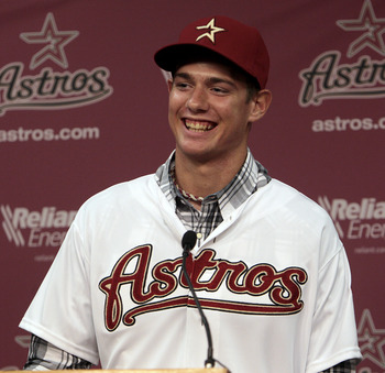 HOUSTON - JUNE 10:  RHP Adrian Houser smiles after being announced as the Houston Astros' second-round selection in the 2011 MLB First Year Player Draft at Minute Maid Park on June 10, 2011 in Houston, Texas.  (Photo by Bob Levey/Getty Images)