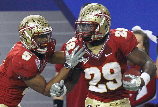 ATLANTA, GA - DECEMBER 31:  Kendall Smith #29 of the Florida State Seminoles reacts with Greg Reid #5 after an interception against the South Carolina Gamecocks during the 2010 Chick-fil-A Bowl at Georgia Dome on December 31, 2010 in Atlanta, Georgia.  (P