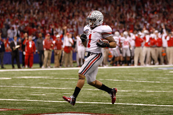NEW ORLEANS, LA - JANUARY 04:  Dan Herron #1 of the Ohio State Buckeyes scores on a nine-yard touchdown run in the first half against the Arkansas Razorbacks during the Allstate Sugar Bowl at the Louisiana Superdome on January 4, 2011 in New Orleans, Loui
