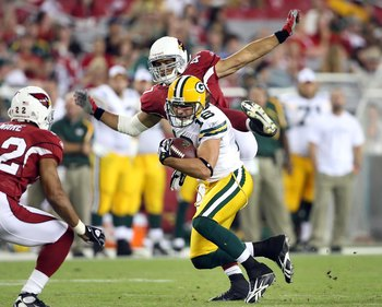 GLENDALE, AZ - AUGUST 28:  Wide receiver Brett Swain #26 of the Green Bay Packers runs with the ball after a reception past Rashad Johnson #41 of the Arizona Cardinals during the preseason NFL game at the Universtity of Phoenix Stadium on August 28, 2009