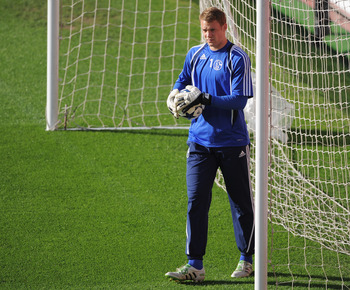 MANCHESTER, ENGLAND - MAY 03:  Manuel Neuer of Schalke looks on during a training session ahead of their UEFA Champions League semi final second leg match against Manchester United at Old Trafford on May 3, 2011 in Manchester, England.  (Photo by Michael
