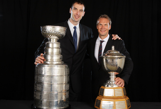 LAS VEGAS, NV - JUNE 22:  (L-R) Zdeno Chara of the Boston Bruins poses with the Stanley Cup and Nicklas Lidstrom of the Detroit Red Wings poses with the James Norris Memorial Trophy during the 2011 NHL Awards at The Pearl concert theater at the Palms Casi