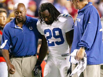LANDOVER, MD - OCTOBER 17:  Running back Joseph Addai #29 of the Indianapolis Colts is helped off the field after being injured against the Washington Redskins at FedEx Field on October 17, 2010 in Landover, Maryland. The Colts won the game 27-24.  (Photo