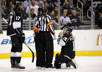 LOS ANGELES, CA - APRIL 25:  Brad Richardson #15 of the Los Angeles Kings talks with the referees after taking a high stick to the face in game six of the Western Conference Quarterfinals against the San Jose Sharks during the 2011 NHL Stanley Cup Playoff