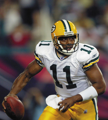 ATLANTA - AUGUST 9:  Akili Smith #11 of the Green Bay Packers rolls out against the Atlanta Falcons on August 9, 2003 at the Georgia Dome in Atlanta, Georgia.  The Packers defeated the Falcons 27-21.  (Photo by Jamie Squire/Getty Images)