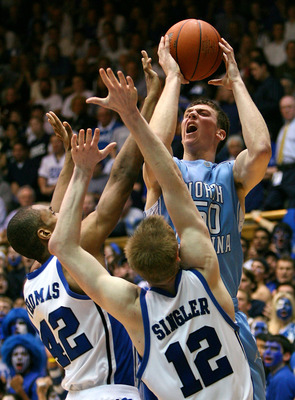 DURHAM, NC - MARCH 8:  Tyler Hansbrough #50 of the North Carolina Tar Heels shoots over Lance Thomas #42 and Kyle Singler #12 of the Duke Blue Devils during the second half at Cameron Indoor Stadium March 8, 2008 in Durham, North Carolina.  North Carolina