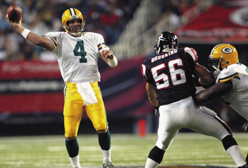 ATLANTA - AUGUST 9:  Brett Favre #4 of the Green Bay Packers passes against the Atlanta Falcons on August 9, 2003 at the Georgia Dome in Atlanta, Georgia.  The Packers defeated the Falcons 27-21.  (Photo by Jamie Squire/Getty Images)