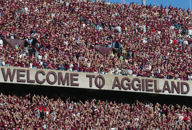 COLLEGE STATION, TX - NOVEMBER 6:  Texas A&M University Aggies fans, sometimes referred to as the 12th Man, watch the game against the University of Oklahoma Sooners on November 6, 2004 at Kyle Field in College Station, Texas. The Sooners defeated the Agg