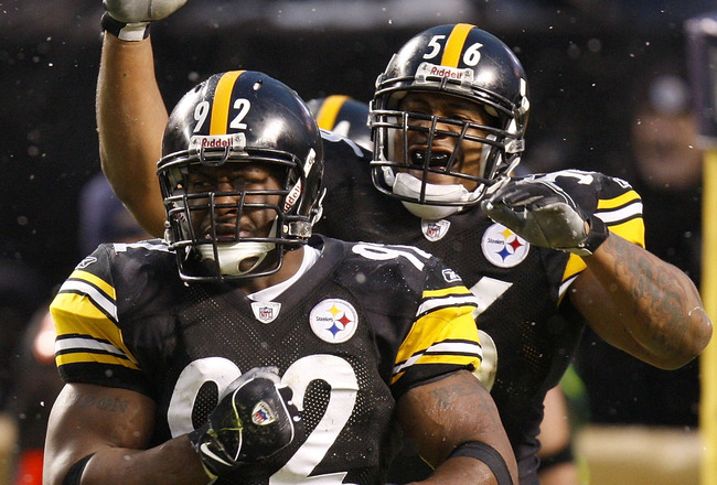 PITTSBURGH - NOVEMBER 16:  James Harrison #92 of the Pittsburgh Steelers is congratulated by LaMarr Woodley #56 after a second quarter saftey while playing the San Diego Chargers on November 16, 2008 at Heinz Field in Pittsburgh, Pennsylvania.  (Photo by