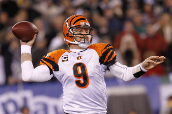 EAST RUTHERFORD, NJ - NOVEMBER 25:  Quarterback Carson Palmer #9 of the Cincinnati Bengals throws a pass against the New York Jets at New Meadowlands Stadium on November 25, 2010 in East Rutherford, New Jersey.  (Photo by Chris Trotman/Getty Images)