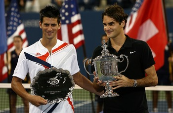 NEW YORK - SEPTEMBER 09:  2007 U.S. Open Men's Singles Champion Roger Federer of Switzerland and runner-up Novak Djokovic of Serbia pose for a photo after the Men's Singles Final on day fourteen of the 2007 U.S. Open in Arthur Ashe Stadium at the Billie J