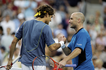 NEW YORK - SEPTEMBER 11:  (L-R) Roger Federer of Switzerland is congratulated at the net by Andre Agassi after Federer won the men's final of the US Open at the USTA National Tennis Center in Flushing Meadows Corona Park on September 11, 2005 in the Flush