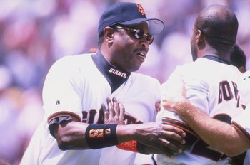 28 Apr 1998:  Manager Dusty Baker talks with outfielder Barry Bonds of the San Francisco Giants during a game against the Pittsburgh Pirates at the 3Com Park in San Francisco, California. The Giants defeated the Pirates 2-1. Mandatory Credit: Jeff Carlick