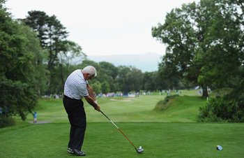 KILLARNEY, IRELAND - JULY 27:  Gerry McIlroy, The father of 2011 U.S. Open Winner, Rory McIlroy of Northern Ireland hits his tee shot during the pro - am prior to the start of the Discover Ireland Irish Open at the Killarney golf and fishing club on July