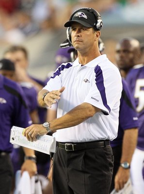 PHILADELPHIA, PA - AUGUST 11:  Head coach John Harbaugh of the Baltimore Ravens walks on the sidelines against the Philadelphia Eagles during their pre season game on August 11, 2011 at Lincoln Financial Field in Philadelphia, Pennsylvania.  (Photo by Jim