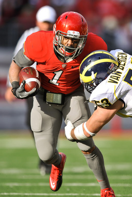 COLUMBUS, OH - NOVEMBER 27:  Dan Herron #1 of the Ohio State Buckeyes  runs with the ball against the Michigan Wolverines at Ohio Stadium on November 27, 2010 in Columbus, Ohio.  (Photo by Jamie Sabau/Getty Images)