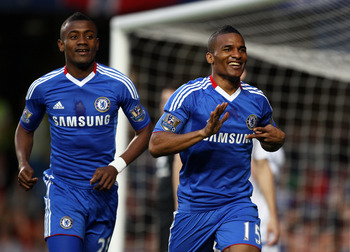 LONDON, ENGLAND - APRIL 20:  Florent Malouda (R) of Chelsea celebrates scoring the opening goal with Salomon Kalou during the Barclays Premier League match between Chelsea and Birmingham City at Stamford Bridge on April 20, 2011 in London, England.  (Phot