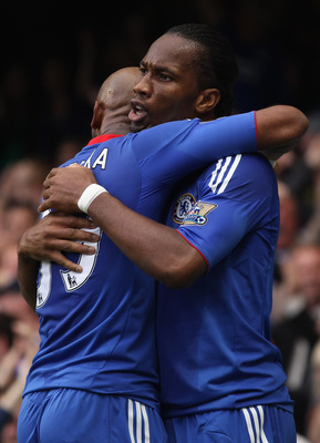 LONDON, ENGLAND - OCTOBER 03:  Didier Drogba of Chelsea celebrates with team mate Nicolas Anelka after scoring during the Barclays Premier League match between Chelsea and Arsenal at Stamford Bridge on October 3, 2010 in London, England.  (Photo by Bryn L