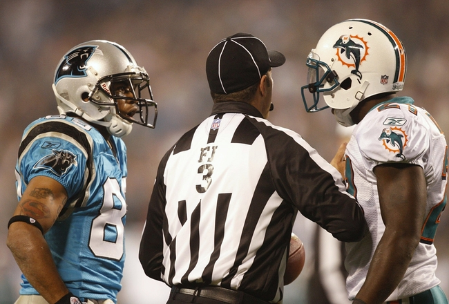 CHARLOTTE - NOVEMBER 19: Steve Smith #89 of the Carolina Panthers and Vontae Davis #21 of the Miami Dolphins are seperated by an official as they exchange words on the field at Bank of America Stadium on November 19, 2009 in Charlotte, North Carolina.  (P