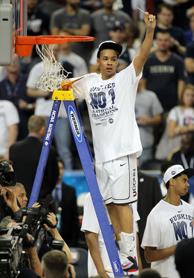 HOUSTON, TX - APRIL 04:  Shabazz Napier #13 of the Connecticut Huskies cuts down the net after defeating the Butler Bulldogs to win the National Championship Game of the 2011 NCAA Division I Men's Basketball Tournament by a score of 53-41 at Reliant Stadi